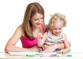 Mother and child painting together — Stock Photo