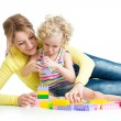 Stock Photo: Little girl and mother with building blocks