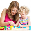 Stock Photo: Child and mother play colorful clay toy