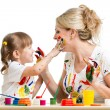 Stock Photo: Mother with daughter paint together