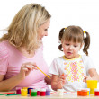 Stock Photo: Mother and child paint together