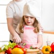 Stock Photo: Mom and kid preparing healthy food