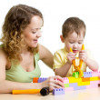 Child and mom play with block toys — Stock Photo