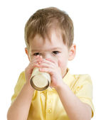 Little child drinking yogurt or kefir isolated — Stock Photo