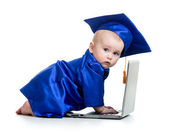 Funny baby in academician clothes  using laptop — Stock Photo