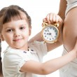 Kid with an alarm clock and pregnant woman belly — Stock Photo #44050571