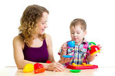 Mother and kid boy playing together — Stock Photo