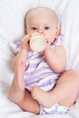 Adorable child drinking milk from bottle — Stock Photo