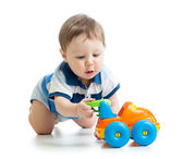 Baby boy playing with car toy — Stock Photo