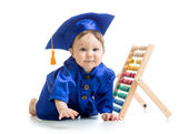 Smiling baby weared academical clothes with counter — Stock Photo