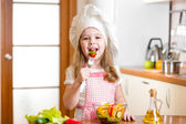 Chef kid tasting healthy food — Stock Photo