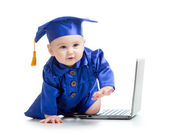 Happy child in academician clothes  with laptop — 图库照片