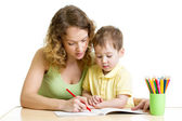 Kid boy and mother draw with colorful pencils — Stock Photo