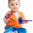 Smiling boy baby with musical toys. Isolated on white backgroun — Stock Photo