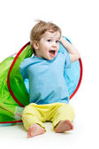 Cheerful baby playing in a tent — Stock Photo