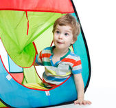Little boy playing in a tent — Stock Photo