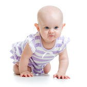 Baby crawling on floor — Stock Photo