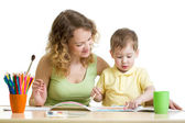 Mother and kid boy paint together — Stock Photo