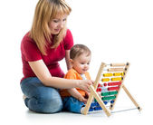 Mother and baby boy play with counter toy — Stock Photo