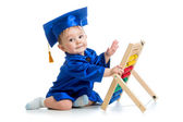 Academic baby playing with abacus toy — Stock Photo