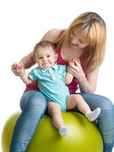 Mom and baby having fun with  gymnastic ball — Stock Photo