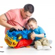 Kid boy and his dad repair toy trunk — Stock Photo #45018875