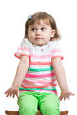 Kid girl looks puzzled, isolated — Stock Photo