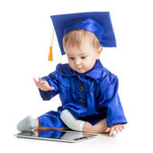 Happy child in academician clothes  with laptop — Stock Photo