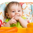 Baby boy sitting in chair ready to feeding — Stock Photo #45407957
