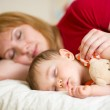 Mother and her baby sleeping together — Stock Photo #45407969