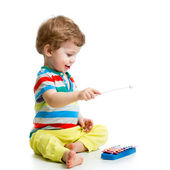 Cute baby playing with musical toys — Stockfoto