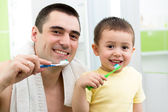 Father and child boy brushing teeth before going to bed — Stock Photo