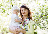 Portrait of mother and baby girl outdoors — Stock Photo