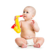 Baby playing musical toy — Stock Photo