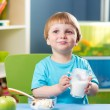 Kid boy drinking milk — Stock Photo