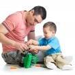 Kid boy and his father repair toy car — Stock Photo #46145309