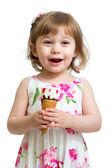 Joyful child girl eating icecream — Stockfoto