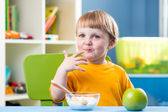 Breakfast for kid boy. Baby eating healthy food. — Stock Photo
