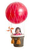 Cheerful kid on hot air balloon — Stock Photo