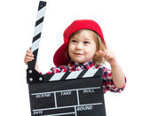 Kid girl holding clapper board in hands isolated — Stok fotoğraf