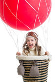 Child playing on hot air balloon — Stock Photo
