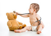 Kid boy playing doctor with toy — Stock Photo