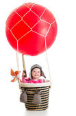 Child with pilot hat and teleskop on hot air balloon — Stock Photo