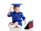 Baby with academic clothes playing tablet PC — Stock Photo