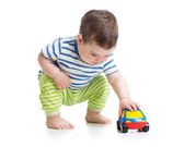 Baby boy toddler playing with toy car — 图库照片