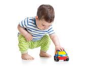 Baby boy toddler playing with toy car — Zdjęcie stockowe