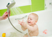 Tempering shower for baby — Stock Photo