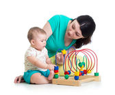 Baby and mother play with color educational toy — Foto de Stock