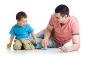 Father and kid play with car toys together — Stock Photo