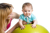 Mother and baby having fun with gymnastic ball — Stock Photo